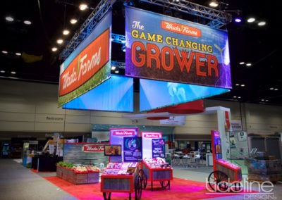 wada-farms-custom-built-20x30-trade-show-display-with-hanging-truss-lighting-banners-01