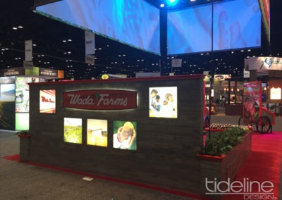 wada-farms-custom-built-20x30-trade-show-display-with-hanging-truss-lighting-banners-07