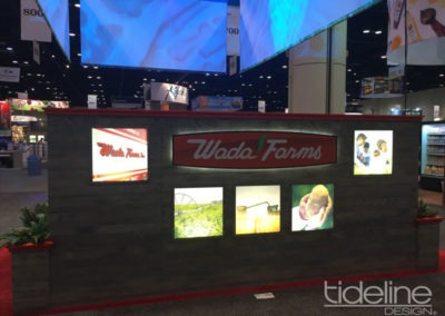 wada-farms-custom-built-20x30-trade-show-display-with-hanging-truss-lighting-banners-08