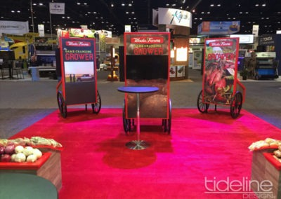 wada-farms-custom-built-20x30-trade-show-display-with-hanging-truss-lighting-banners-15