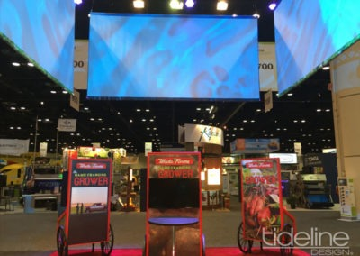 wada-farms-custom-built-20x30-trade-show-display-with-hanging-truss-lighting-banners-17