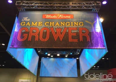 wada-farms-custom-built-20x30-trade-show-display-with-hanging-truss-lighting-banners-21