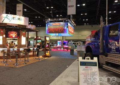 wada-farms-custom-built-20x30-trade-show-display-with-hanging-truss-lighting-banners-23