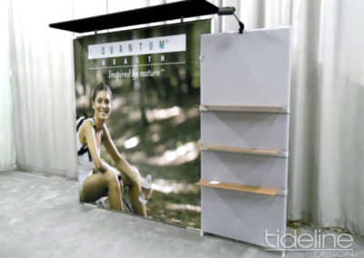 quantum-medallion-large-back-lit-trade-show-display-with-custom-canopy-and-product-shelving-06